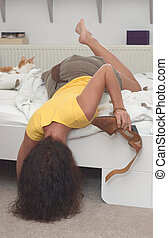 searching under bed - woman searching under bed