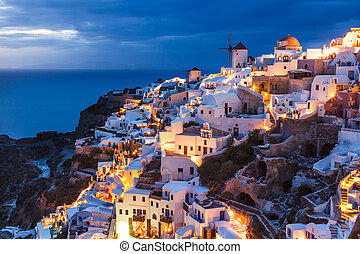 Night shot Oia Santorini Greece - Dusk overlooking buildings...