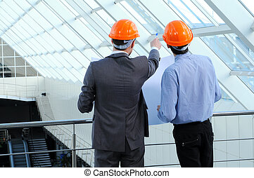 Construction workers - Two men in hard hats at construction...