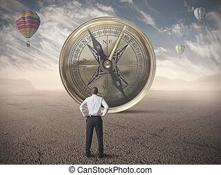 Business compass - Businessman looking for the destination...