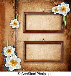 Framework for photo with spring flowers over old paper album cover