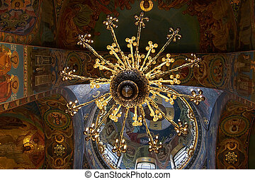 Chandelier and ceiling mosaics in orthodox church
