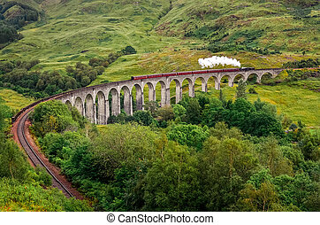 View of a steam train on a famous Glenfinnan viaduct,...