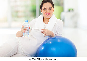 pregnant woman with a bottle of water