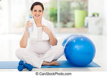 pregnant woman holding bottle of water - beautiful pregnant...