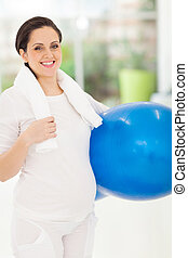 caucasian pregnant woman holding fitness ball - gorgeous...