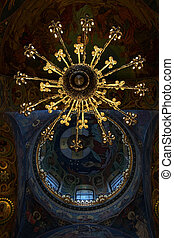 Chandelier and ceiling mosaics in orthodox temple