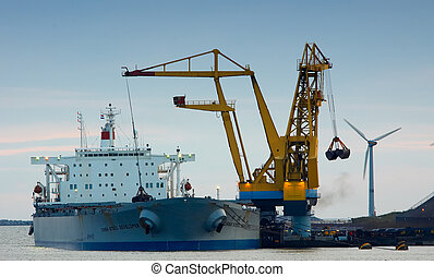 cargo ship - unloading a ship in the harbor