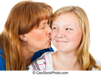 Mom Kisses Teen Daughter - Mother kissing her pretty blond...