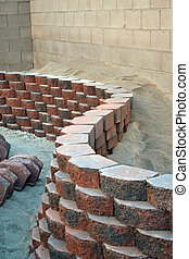 Retaining wall - red curvy brick stone retaining wall
