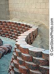 Retaining wall - red curvy brick stone retaining wall