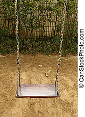 swing set on the playground - close-up wooden swing set on...
