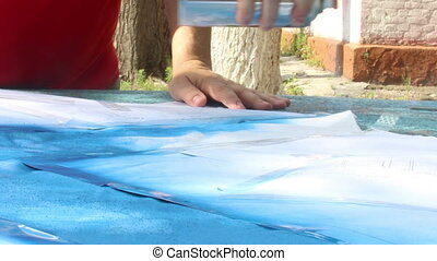 painting with spray can - close-up painting a pattern at...