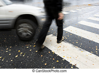 dangerous crossing - Man on pedestrian crossing in autumn,...
