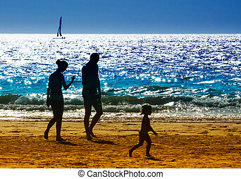 family on the beach - family on a beautiful day in summer