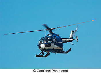 helicopter - Photo of a helicopter against a blue sky