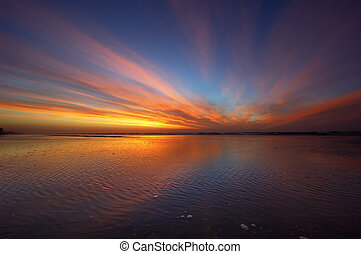 colorful sunset - Colorful sunset on a beach in the...