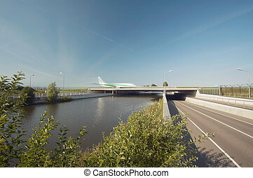 A bridge for planes - Planes go over the bridge near...