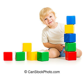 kid playing with colorful blocks