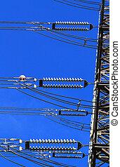 Electric high voltage pillar Closeup of insulators Sky