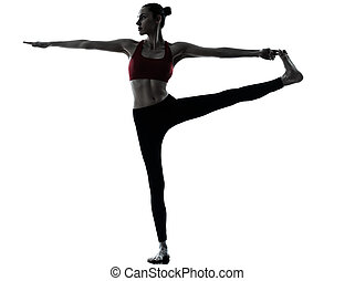 woman exercising yoga Hasta Padangusthasana - one caucasian...