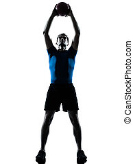 man exercising workout holding fitness ball posture