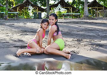 Posing Wet - Two young girls posing after going out of the...