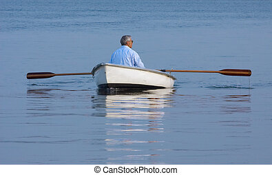 rowing - A man in a boat on calm water