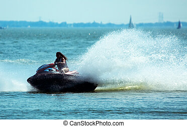 Summer jetski Fun - Woman on a jet-ski having fun