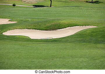Sand trap or bunker on a golf course - Curving sand trap or...