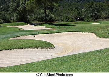 Sand trap or bunker on a manicured fairway on a golf course...