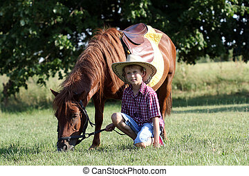 happy boy with pony horse pet