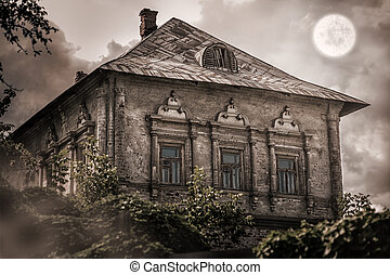old abandoned empty house in forest - Halloween concept. old...