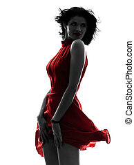 sexy woman in red dress silhouette - one caucasian fashion...