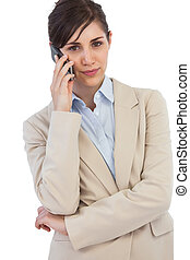 Self assured businesswoman on the phone against white...