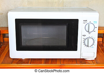 Microwave oven on the table in kitchen