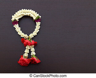 Garland of jasmine flower on wood background blank for text