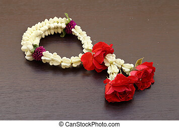 Garland of jasmine flower on wood background