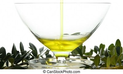 olive oil running into a bowl