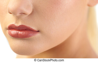 Close up on voluminous glossy lips on white background