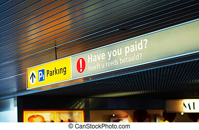 pay for parking sign at the airport