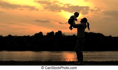 silhouettes of a woman and child