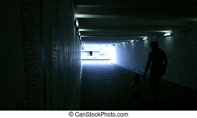 woman and child in the tunnel - woman and child walking in...