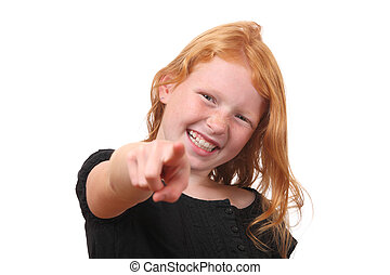 Pointing - Happy young girl points to camera on white...