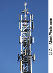 Telco Tower - Telecommunication tower with antennas on blue...