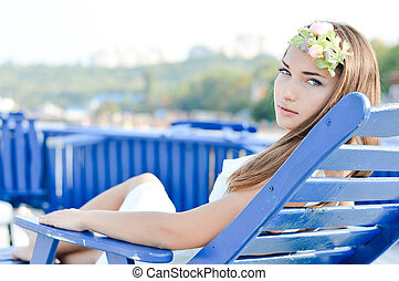 Young woman enjoying sunny day on the beach - Portrait of...