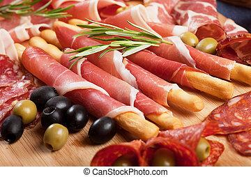 Italian prosciutto di Parma, classic italian antipasto food