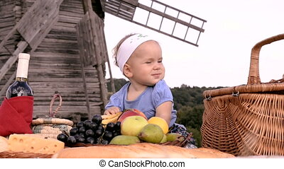 a small girl on countryside picnic