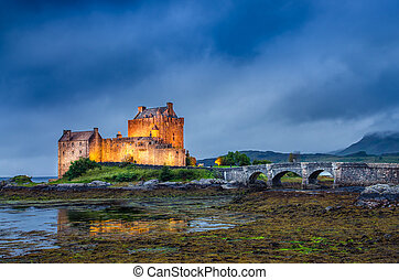 View of Eilean Donan castle at sunset in Scottish highlands...