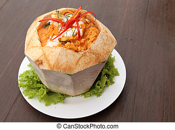 Steamed fish and seafood with curry paste in coconut -...